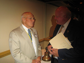 Photo: President Blaine talks after the Installation and Awards Banquet with District Governor Bill Griffin - June 6, 2009