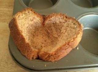 Take slices of bread and press in muffin pans, Brush each with butter.Place in...