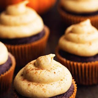 Chocolate Pumpkin Cupcakes with Cinnamon Pumpkin Cream Cheese Frosting.