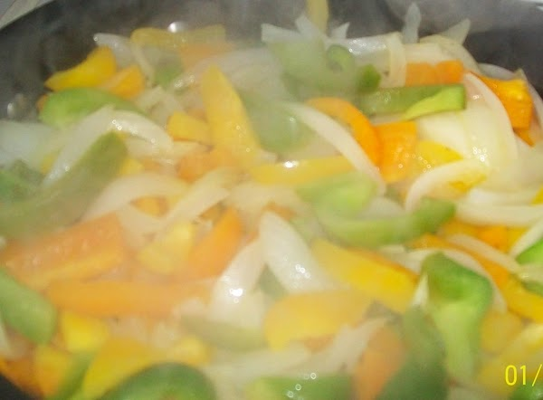 Fry the onions, peppers and garlic till the onions are translucent.