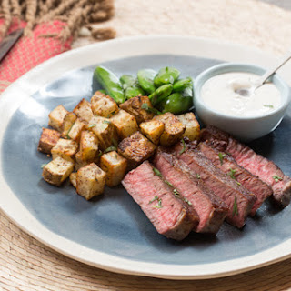 Seared Steak & Spiced Potato with Sautéed Sugar Snap Peas & Tarragon-Labneh Sauce