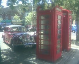 Photo: An epitome of Britishness.  The old Riley back from a summer show at The Petwood Hotel, parked by the phoneboxes on the market, with uniformed grammar school pupils enjoying their dinner break in the Sun.