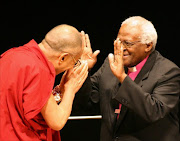 Archbishop Emeritsus Desmond Tutu (R) of South Africa welcomes exiled Tibetan spritual leader Dalai Lama prior to the international peace conference in Hiroshima, 02 November 2006. Nobel laureates, including Tutu, are urging China to hold talks with the Dalai Lama in light of recent Tibetan self-immolations to understand Tibetans' grievances and find a non-violent solution.