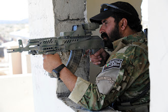 Photo: Afghan National Police Commander Azizullah uses the scope on his rifle to scan the area for insurgent activity along the Afghan and Pakistan border, Paktika province, Afghanistan, Sept. 23, 2010.(U.S. Army photo by Sgt. Justin P. Morelli / Released)