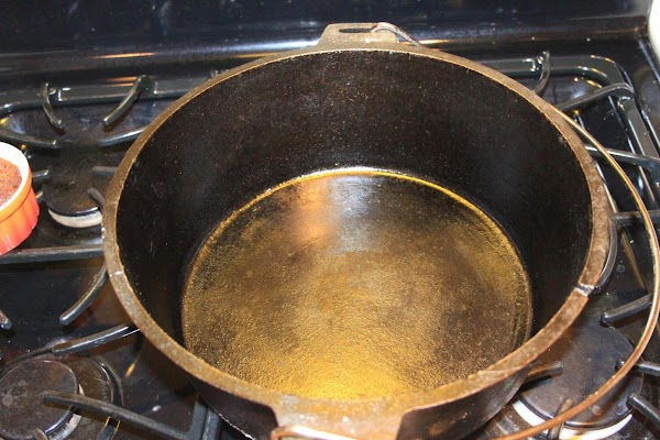 Pictured is a dutch oven very similar to mine that I use for frying....