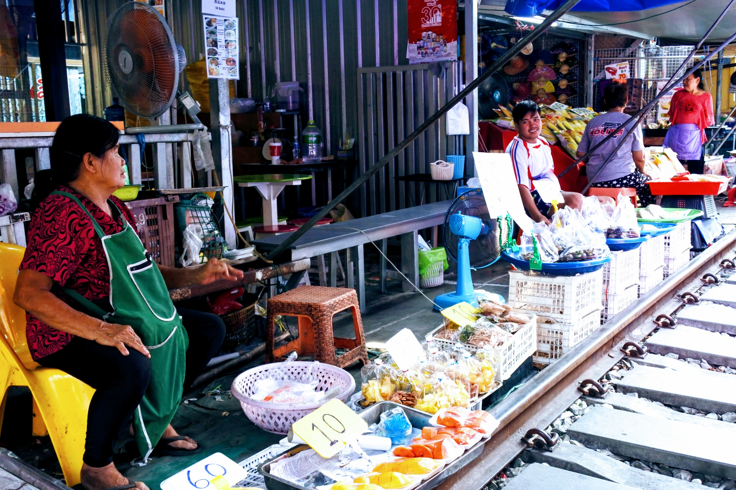 Maeklong Railway Market is a market on a railway track