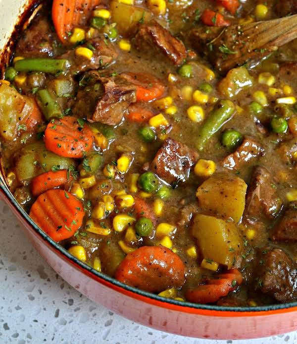 Mulligan Stew Is A Family Friendly Easy Stew Made With Tender Stew Meat, Potatoes, Corn, Carrots, Peas, Green Beans And A Perfect Blend Of Italian Spices.  This Delectable Stew Is Easily Made In A Dutch Oven But Can Be Adapted For A Slow Cooker.