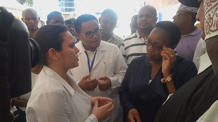 Orthopaedic surgeon Dr Liliana Casos, and Dr Dennis Orozco, a family physician, speak to former Health CS Sicily Kariuki at the King Fahad hospital in Lamu in 2018.