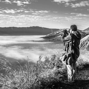 the man, the toy, and the mountains by Said Rizky - People Portraits of Men