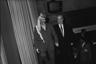 """Photo: DAVOS/SWITZERLAND, JAN 1994 - Yasser Arafat, Chairman of the PLO, with Shimon Peres, Israeli Minister of Foreign Affairs at the Annual Meeting of the World Economic Forum in Davos in 1994. Copyright <a href=""""http://www.weforum.org"""">World Economic Forum</a> (<a href=""""http://www.weforum.org"""">http://www.weforum.org</a>)"""