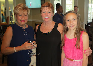 Photo: Having a good time prior to the Banquet is Susan Weisman, Kathy Alemany and Kathy and Joe's 11 year old granddaughter Natalie. Natalie is a top ballet dancer.
