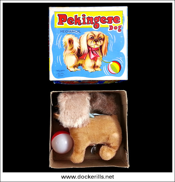 Photo: Alps 'Pekingese Dog', Japan. Clockwork/Plush covered Tinplate. (Picture 1 of 2)  Novelty toy, the dog appears to chase the ball.  The box is 00.00 x 0.00 x 0.00 inches approx.  Visit my blog - Collecting Tin Toys at  http://tinplatetoys.blogspot.com/