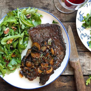Mushroom-smothered Steaks With Arugula-walnut Salad