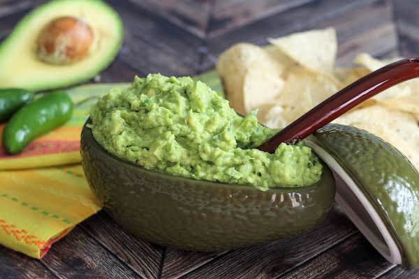 A Bowl Of Chunky Guacamole With Cumin.
