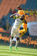 Anthony Laffor of Mamelodi  Sundowns and Letlhogonolo Mirwa of    Kaizer Chiefs during the  Shell Helix Ultra Cup at FNB Stadium on Saturday.