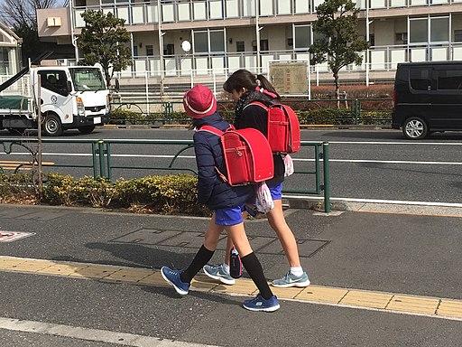Japanese school kids carrying randoseru