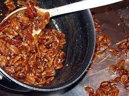 Add pecans to sauce and mix to coat.  Pour pecans onto wax paper...