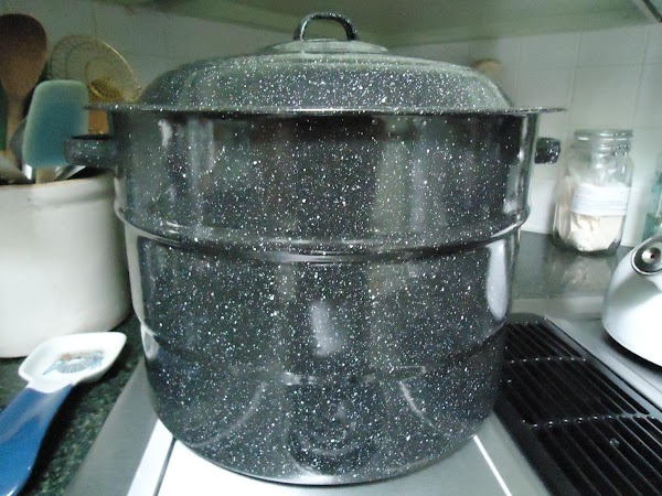 Bring boiling-water canner, half-full with water to simmer. Wash jars and screw tops in your...