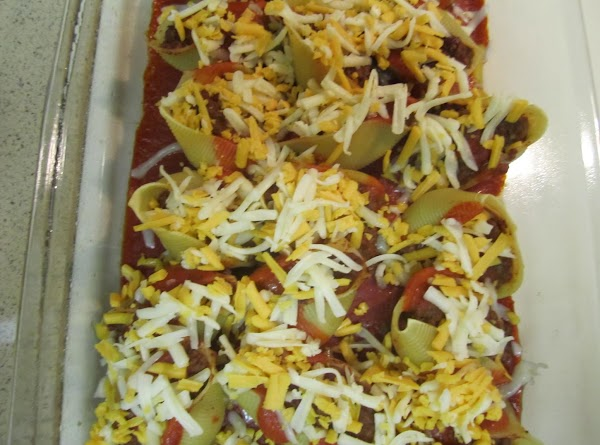 Fill each cooked pasta shell with the beef mix.   Coat an 9x13 inch baking...