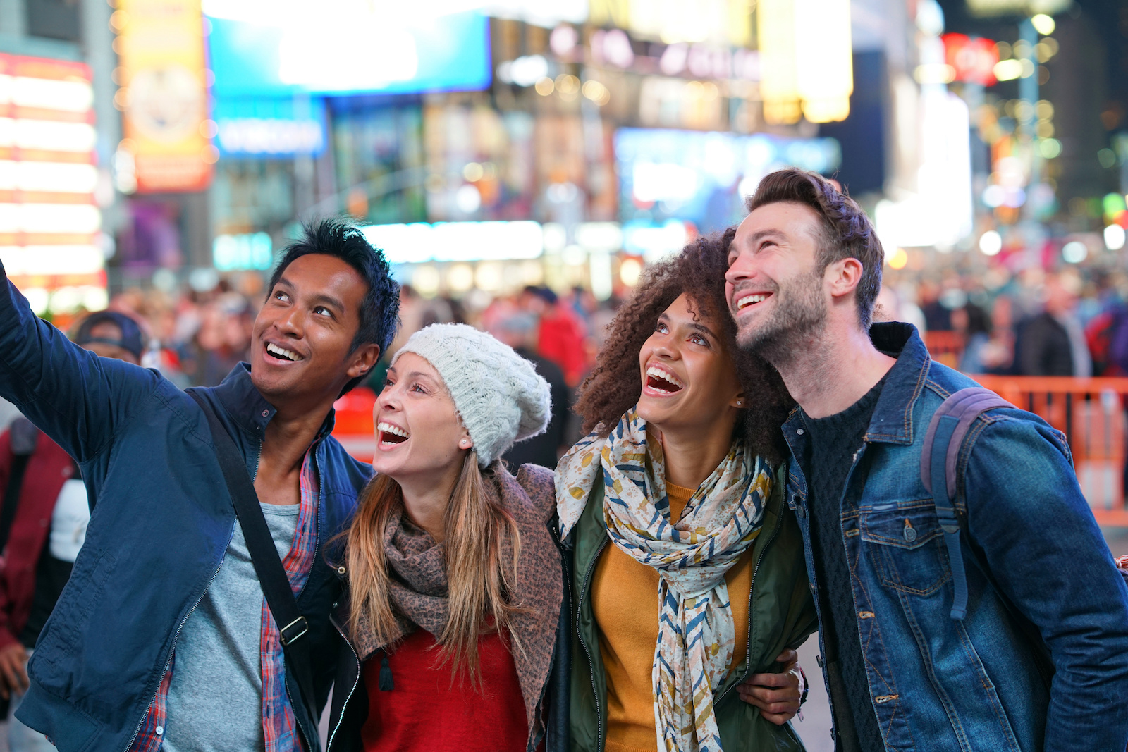 internships in NYC: four happy people  looking up