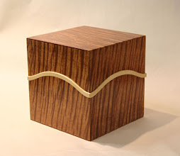 Photo: Quilted Queensland Maple and Rock Maple a   200mm cube Doug Wait