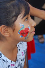 Photo: Cheek art painted by Bella the Clown in Highland, Ca Call to book Bella today at 888-750-7024