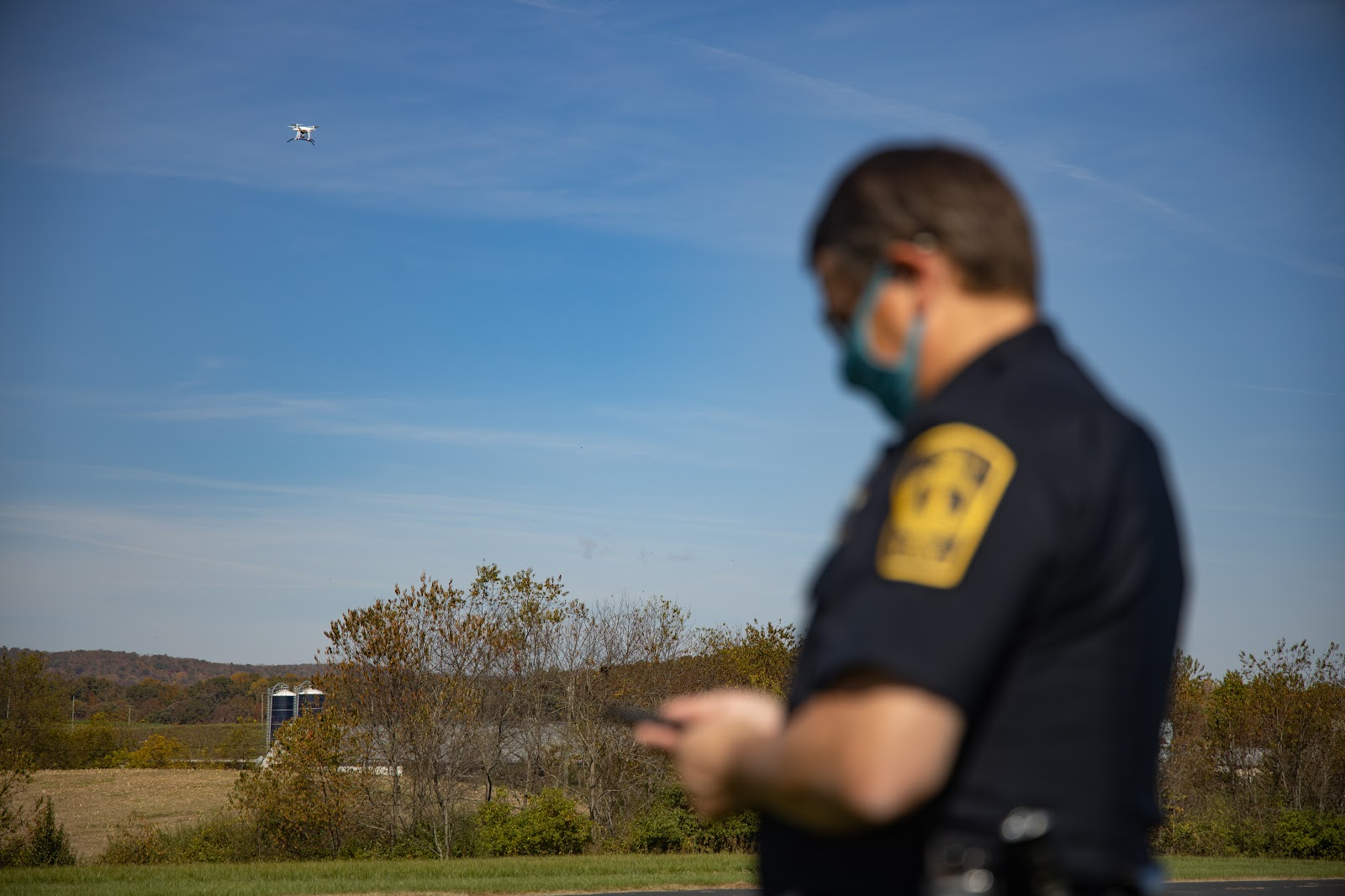 Police officer using remote ID to track drone activity in the area