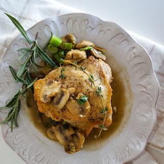 Crispy Skinned Chicken Thighs with Sautéed Mushrooms and Mushroom Sauce