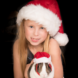 Christmas Bunny by Myra Brizendine Wilson - Babies & Children Child Portraits ( pets, girl, bunny, christmas, girl and bunny, summer, pet, child )