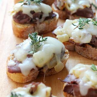 Six-Ingredient Philly Cheesesteak Crostini w/ Mozzarella & Thyme.