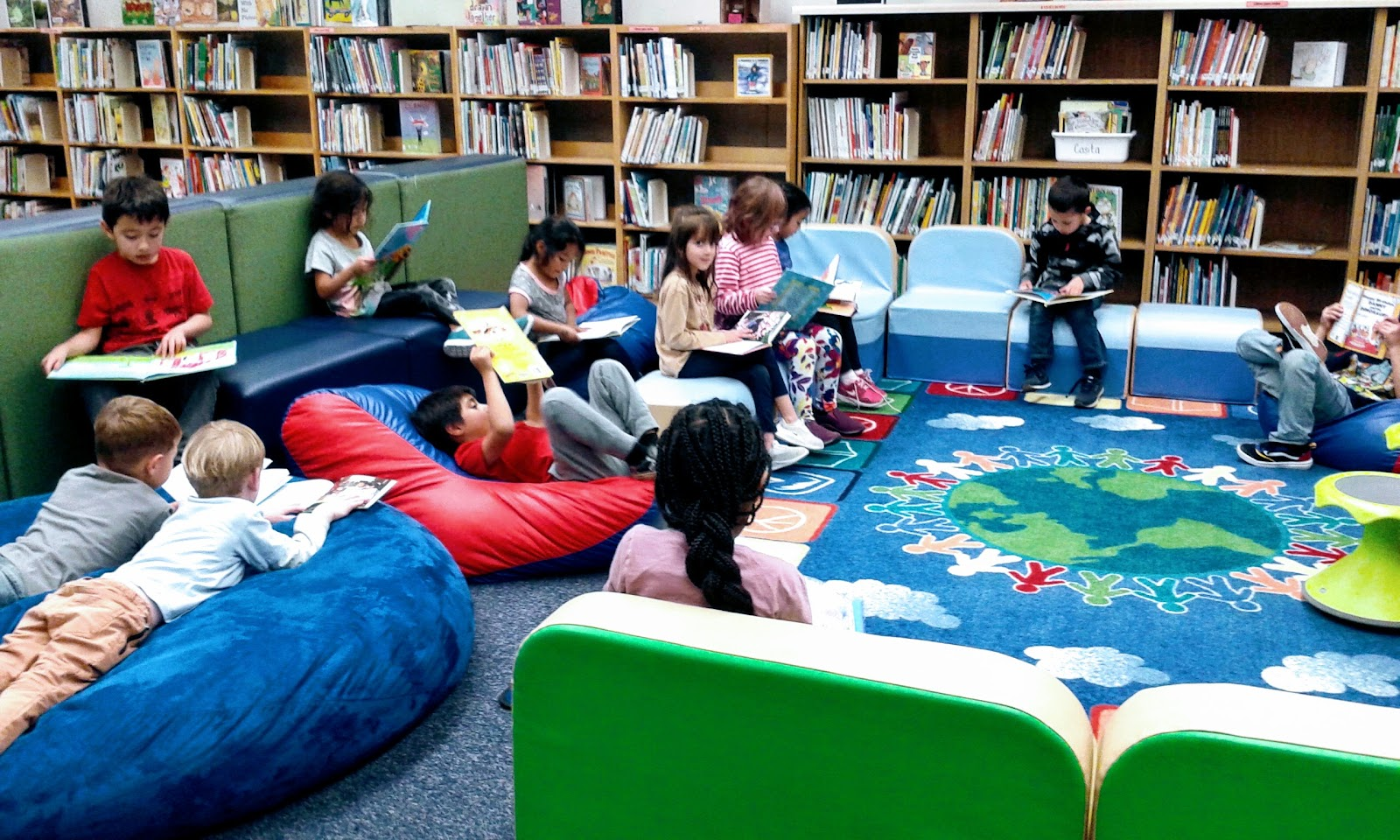 Students enjoying reading books in the library