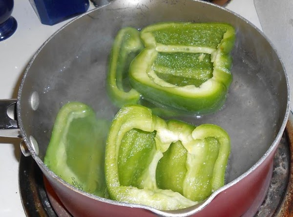 Remove tops and seeds from peppers. Cut in half lengthwise and cook in boiling...