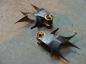 Photo: Two seat lugs, piping hot after I braze in the one bolt binders.  The second lug is for an upcoming frame, thought I'd save some time by doing both at the same time.
