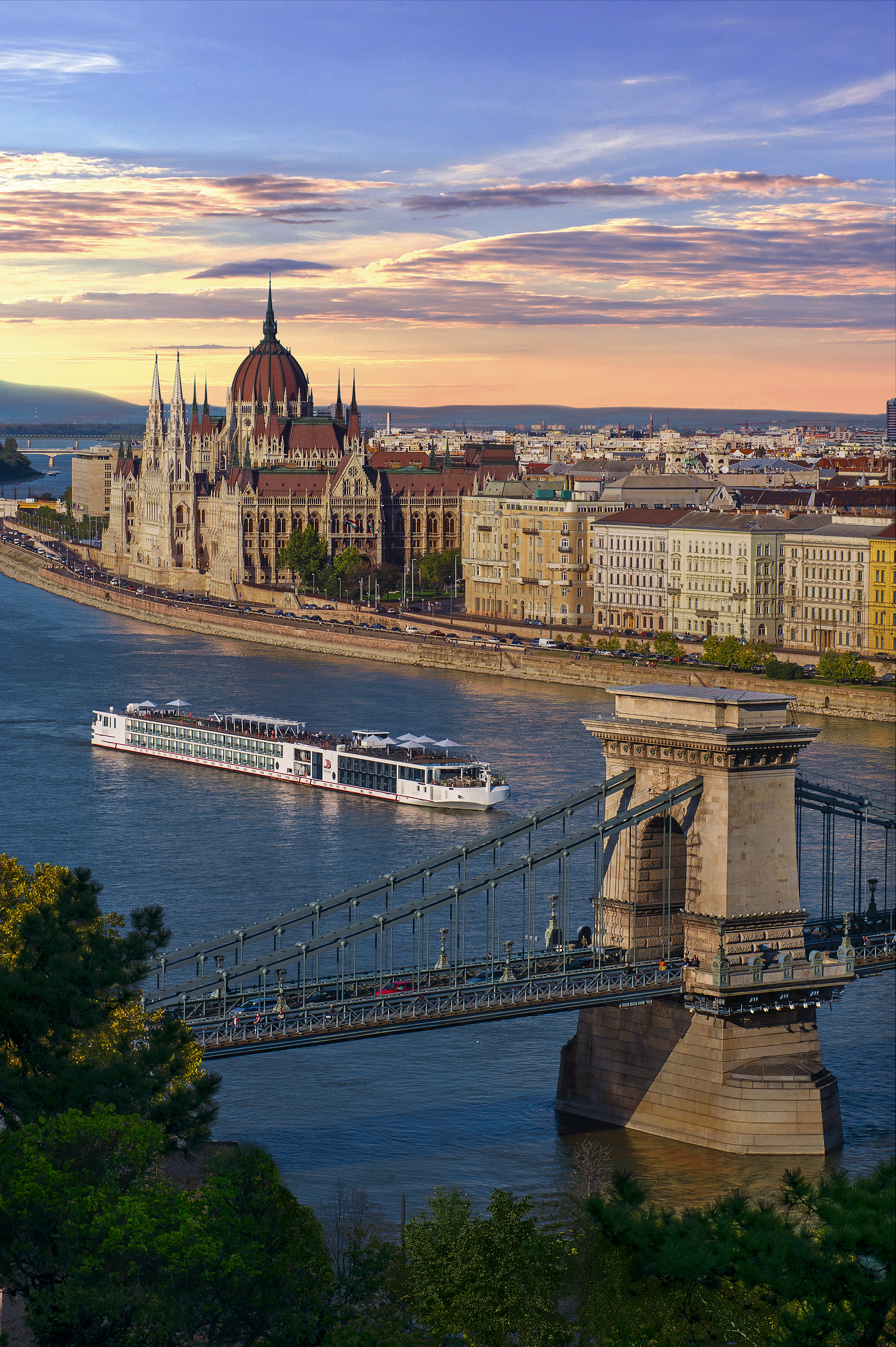 A Viking longship cruises through Budapest