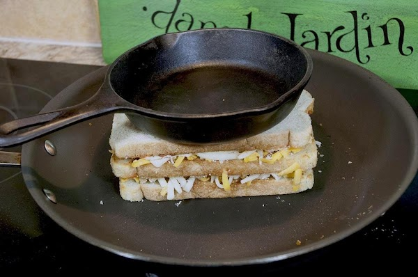 Allow the sandwich to cook until the bottom begins to brown, and the cheeses...