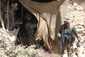 Photo: Afghan Commandos from 1st Company, 2nd Kandak, with assistance from U.S. Special Forces, search a village during a mission on May 28, 2011 in Paktya Province, Afghanistan. The operation was executed to search the village for insurgent fighters and anti-coalition propaganda in the area. (U.S. Army photo by Pfc. Andrew Vidakovich/Released)