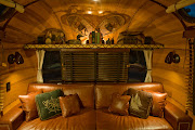 Photo: With it's rich wood interior of Hickory, Douglas Fir, Mahogany, Alder, Tempered Masonite, Birch Bark, leather and more, This Vintage Vacations completely redesigned 1977 Airstream International Sovereign travel trailer gives off the perfect warmth and glow that one might expect to find in a high end 1930's cabin in the Adirondack Mountains. Built by Craig Dorsey