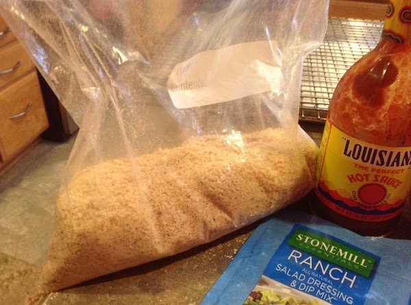 In a large gallon size zip lock bag add the parmesan cheese, dry ranch...