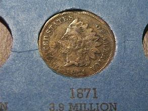 Photo: Damaged and slightly misshapen; valuable date $30
