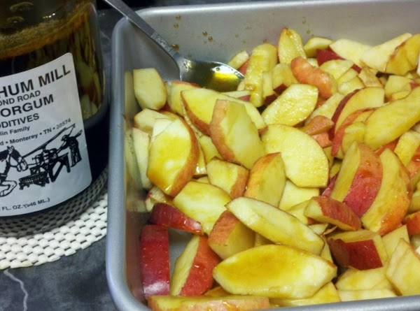 Preheat oven to 375°. Grease a 2-quart square baking dish. Place apples in the...