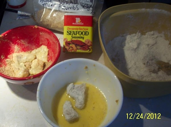 Put flour in one bowl.Beaten egg , with a little milk (very little)in another...