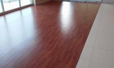 Photo: LONESEAL WOOD GRAIN VINYL flooring installed in CarMaxx show room
