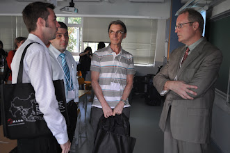 Photo: John Plagens (right) discussing with teachers from Concordia International School, Hong Kong after his breakout session.
