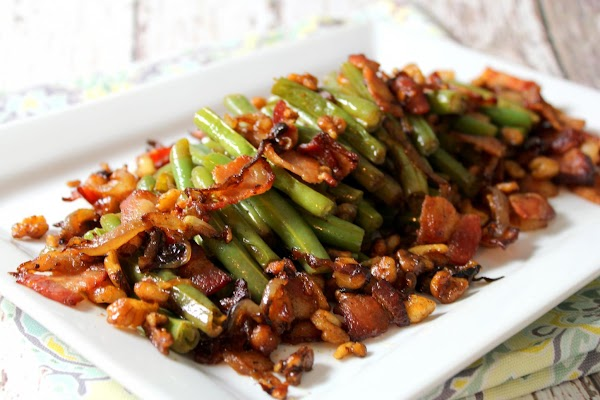 Serve on a platter, arranging beans all in the same direction. Spoon bacon, walnut,...