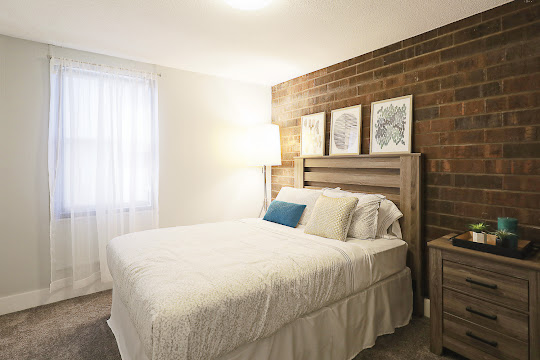 Cozy bedroom with brick accent wall
