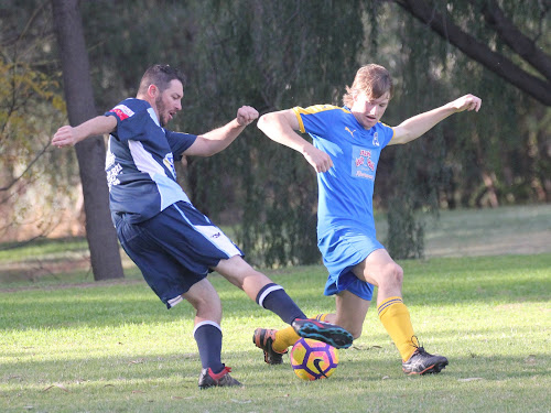 Narrabri FC's Danny Laws turns a Moree Two defender on the left wing on Saturday afternoon in Moree.