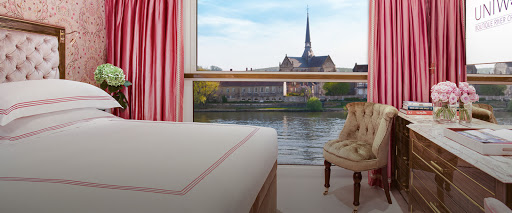 Staterooms on Uniworld's S.S. Joie de Vivre feature Savoir of England beds.