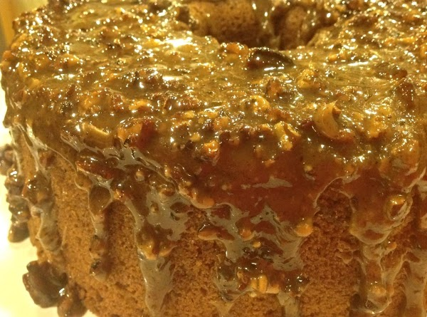 Cool until glaze thickens slightly, then carefully drizzle over top of cake and allow...