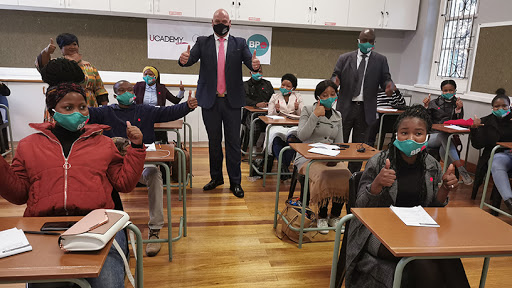 Alderman James Vos, Cape Town's mayoral committee member for economic opportunities and asset management, with students at the BPO skills academy.