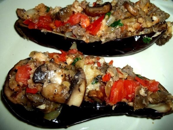 Take your hollowed out eggplants and place back into shallow baking dish. Stuff each...